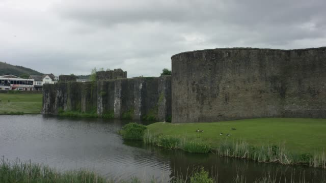 moat and external wall of caerphilly castle - moat stock videos & royalty-free footage