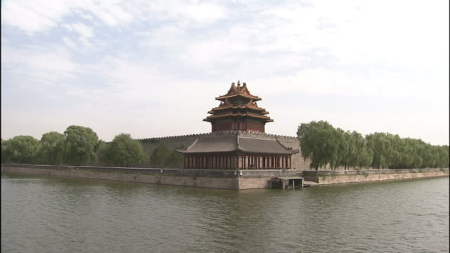 a moat borders a pagoda in the forbidden city, beijing. - pagoda stock videos & royalty-free footage