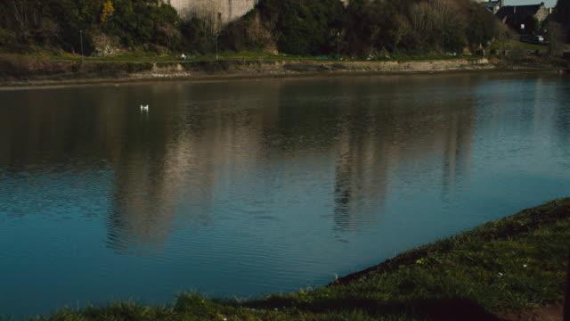 ws moat surrounding pembroke castle / pembroke, wales, united kingdom - breitwandformat stock-videos und b-roll-filmmaterial