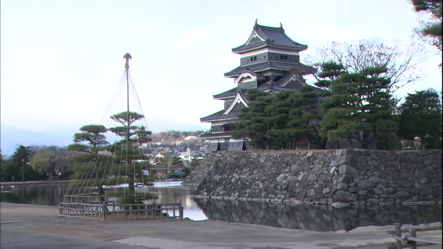 a moat surrounds matsumoto castle in nagano. - moat stock videos and b-roll footage