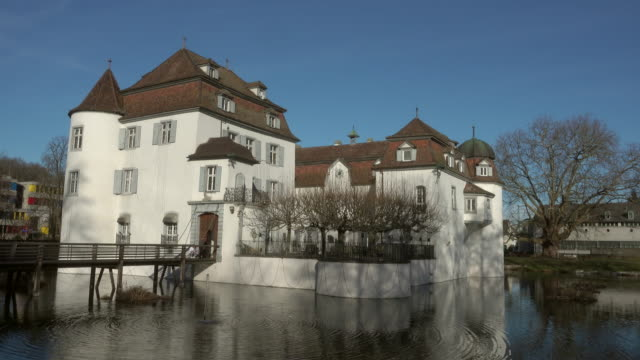 Moated Castle with Restaurant, surrounded by water