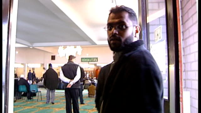 moazzam begg arrested on suspicion of attending a terrorist training camp; t10030646 / begg in doorway speaking to camera - moazzam begg stock videos & royalty-free footage