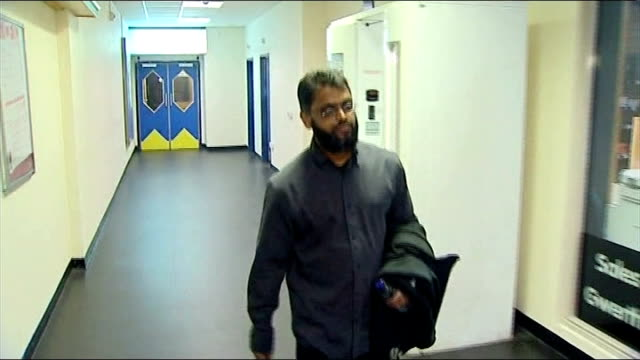 moazzam begg arrested on suspicion of attending a terrorist training camp; t04020940 / int begg along corridor - moazzam begg stock videos & royalty-free footage
