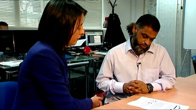 moazzam begg arrested on suspicion of attending a terrorist training camp; t28051301 / moazzam begg sitting talking with reporter - moazzam begg stock videos & royalty-free footage