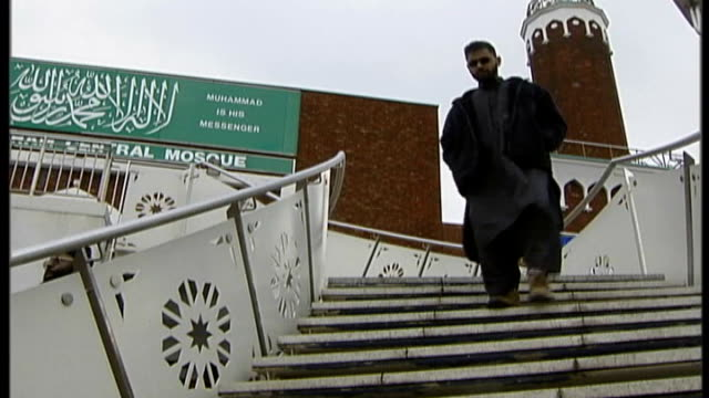 moazzam begg arrested on suspicion of attending a terrorist training camp; t10030646 / england: birmingham: ext begg down steps outside mosque - moazzam begg stock videos & royalty-free footage