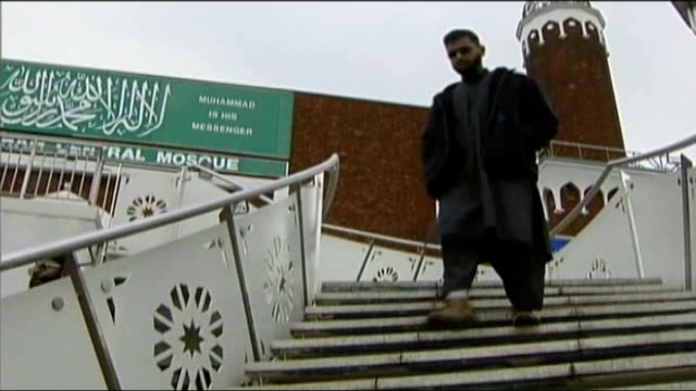 moazzam begg arrested on suspicion of attending a terrorist training camp; t10030646 / ext begg down steps outside mosque - moazzam begg stock videos & royalty-free footage