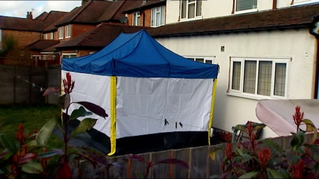 moazzam begg arrested on suspicion of attending a terrorist training camp; england: birmingham: ext rear of house pull out forensic tent in garden... - moazzam begg stock videos & royalty-free footage
