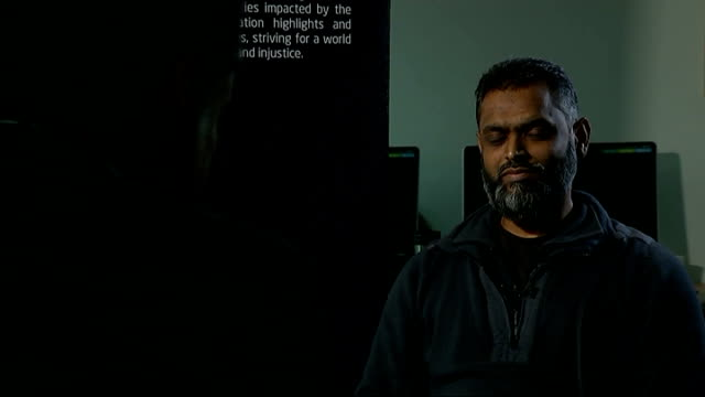 moazzam begg claims he offered to help government secure release of british hostage alan henning; int moazzam begg set up shot with reporter /... - moazzam begg stock videos & royalty-free footage