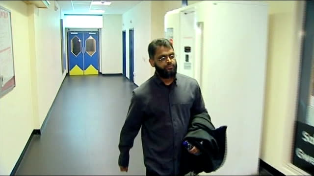 moazzam begg claims he offered to help government secure release of british hostage alan henning; t04020940 / tx 4.2.2009 int begg along corridor - moazzam begg stock videos & royalty-free footage