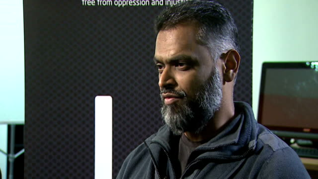 moazzam begg claims he offered to help government secure release of british hostage alan henning; moazzam begg interview sot - - to simply dismiss it... - moazzam begg stock videos & royalty-free footage