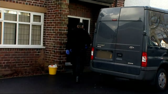 moazzam begg freed days prior to start of trial; england: birmingham: police officers along to the home of moazzam begg after his arrest hand of... - moazzam begg stock videos & royalty-free footage
