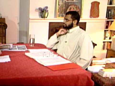 moazzam begg interview: former guantanamo bay detainee; england int side lms moazzam begg sat at table zoom in moazzam begg interview sot - they... - moazzam begg stock videos & royalty-free footage