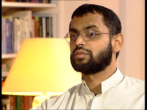 vídeos de stock, filmes e b-roll de former guantanamo bay detainee int logo on screen moazzam begg interview sot i don't think it was as austere as people make out / you don't know... - moazzam begg