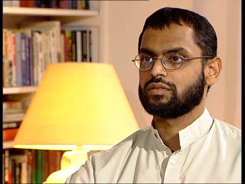 vídeos de stock, filmes e b-roll de former guantanamo bay detainee int logo on screen moazzam begg interview sot i don't think i can ever be back to normality and i'm still trying to... - moazzam begg