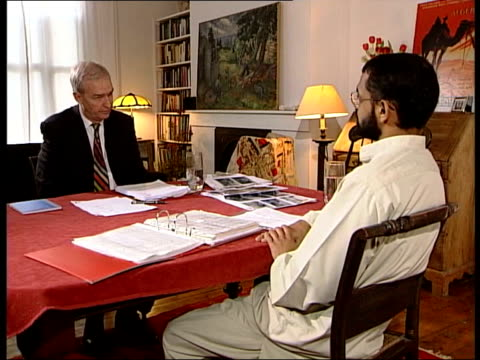 vídeos de stock, filmes e b-roll de moazzam begg sitting conducting interview with jon snow moazzam begg interview sot i witnessed two people being beaten so badly i believe it caused... - moazzam begg