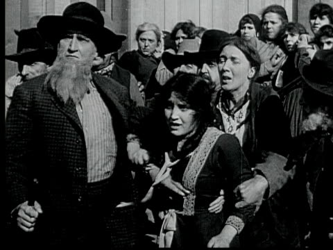 1916 b/w montage ms ws ha mob moving towards defending group of people and breaking into church, 1880s / santa monica, california, usa - 1910 stock videos & royalty-free footage
