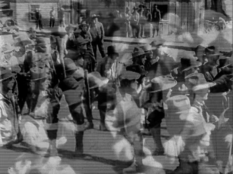 Mob of angry men some brandish sticks fictional film Angry mob with sticks on January 01 1932