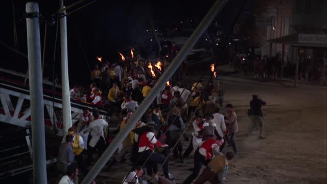 ws mob of men fighting on boat landing - mob stock-videos und b-roll-filmmaterial