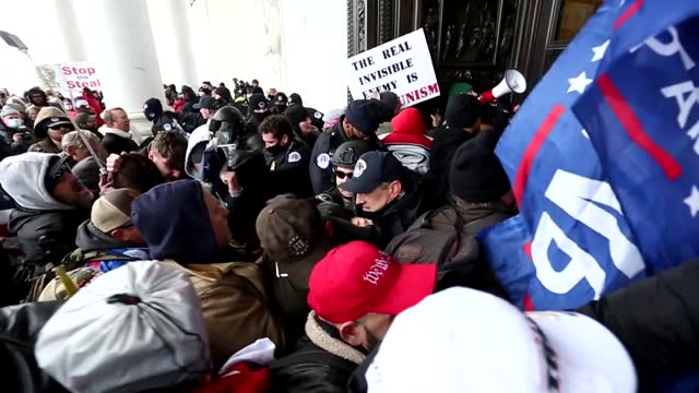 mob of pro-trump rioters and protesters break into the u.s. capitol under siege and fight with police. - washington dc stock videos & royalty-free footage