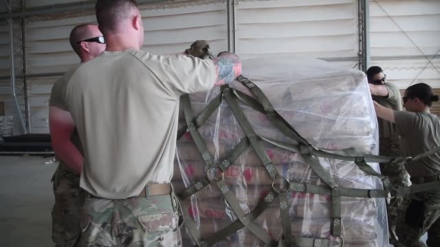 mobile aerial porters prepared us agency for international development supplies for transportation at camp lemonnier djibouti april 1in response to... - 後を追う点の映像素材/bロール