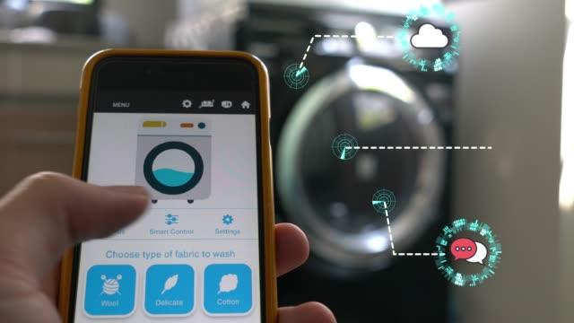 applicazione mobile per domotica e tecnologia smart home - smart wash - remote control video stock e b–roll