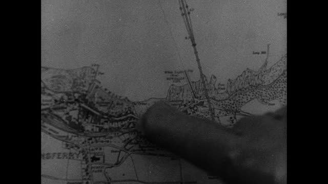 b/w mobile balloon squadron deploying around forth bridge, trucks driving, wheels spinning in mud, tight lanes, airmen getting out and pushing, and hand pointing at map / rosyth, scotland, united kingdom - fluss firth of forth stock-videos und b-roll-filmmaterial