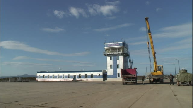 A mobile crane makes a lift at the Mendeleyevo Airport construction site.