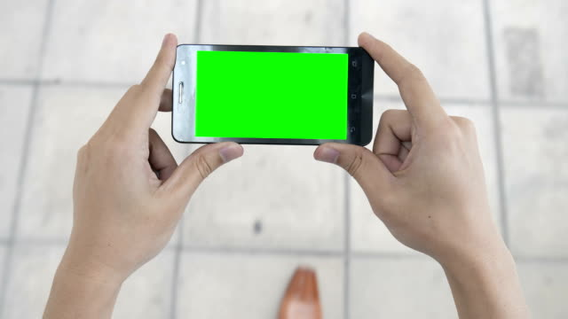 mobile device green screen to show your idea - classified ad stock videos and b-roll footage