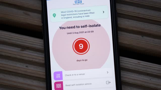 mobile device with the nhs track and track app notifying the user to self isolate after coming in contact with someone who has tested positive for... - covid 19 stock videos & royalty-free footage