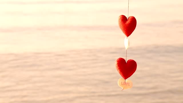 mobile heart hanging on the seafront. - hanging mobile stock videos & royalty-free footage