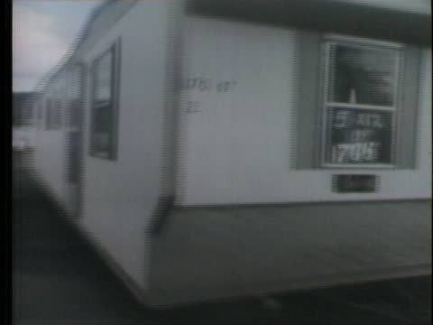 mobile homes are delivered to residents in wilkes-barre, pennsylvania after hurricane agnes caused flooding that left massive destruction. - wilkes barre stock videos & royalty-free footage