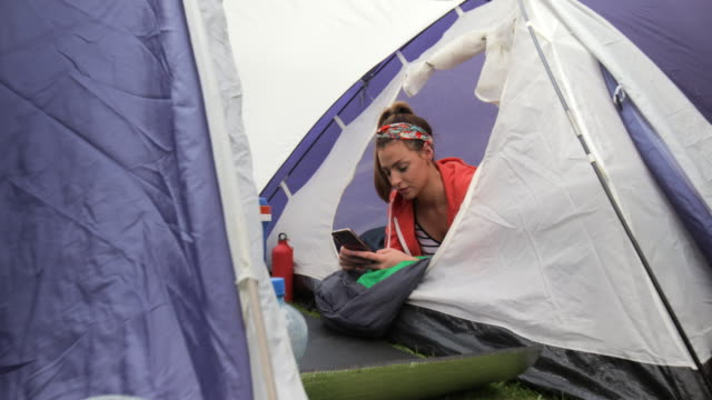 mobile in the tent - lying on front stock videos & royalty-free footage