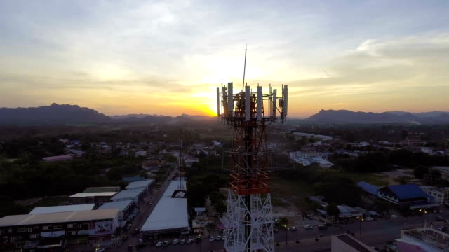 Mobile Modern Telecom Tower with Dusk Sky in Countryside Area