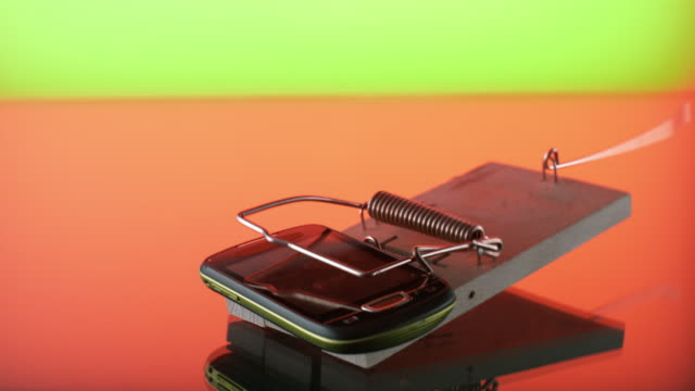 slo mo ld mobile phone falling into a mouse trap - cordless phone stock videos & royalty-free footage