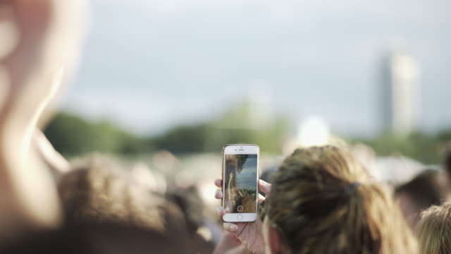 mobile phone recording at a concert - filming stock videos and b-roll footage
