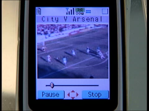 unknown 3g mobile phone shop football match on screen of mobile phone computer screen showing playboy website dvd players on display boots sign pull... - 3g stock videos & royalty-free footage
