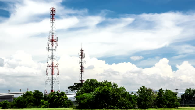 mobile phone tower against blue sky - microwave tower stock videos & royalty-free footage