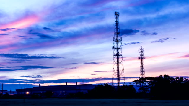 mobile phone tower at twilight morning - microwave tower stock videos and b-roll footage