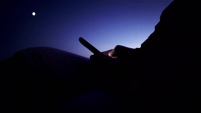 mobile phone use man and night view - distillery still stock videos and b-roll footage