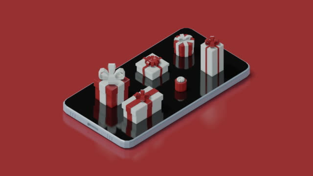 mobile phone with christmas presents - digital animation stock videos & royalty-free footage