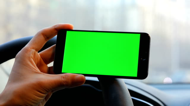 Mobile phone with green screen in car,chroma key