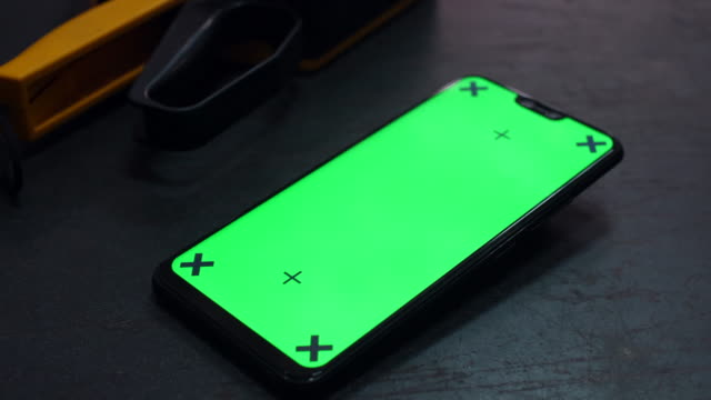 mobile phone with green screen on workshop table, chroma key - strike industrial action stock videos & royalty-free footage