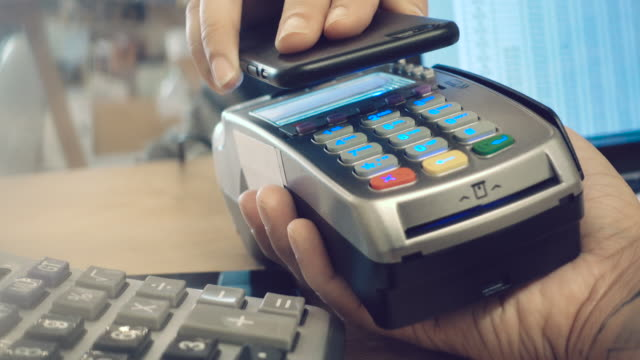 mobile/contactless payment 4k - electronic banking stock videos & royalty-free footage