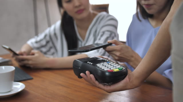 mobile/contactless payment in cafe - mobile payment stock videos & royalty-free footage