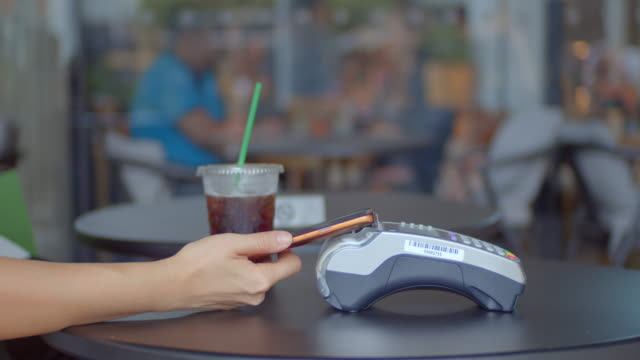 mobile/contactless payment in the cafe,close-up - tap to pay stock videos & royalty-free footage