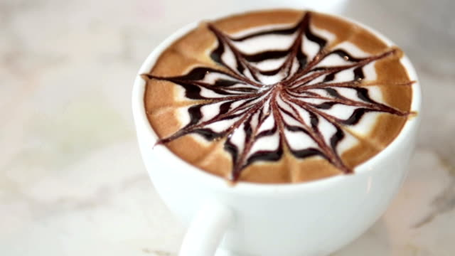 mocha coffee has a chocolate flavor,coffee with chocolate. - froth art stock videos and b-roll footage