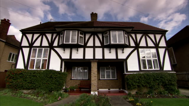 a mock-tudor semi-detached 1930s house in the rayners lane district of london. available in hd. - erkerfenster stock-videos und b-roll-filmmaterial
