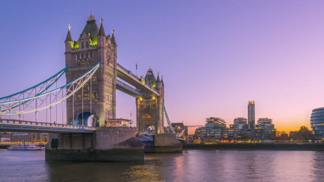 moco time-lapse sequence of the sunset to night transition over tower bridge and london skyline. - tower bridge stock videos & royalty-free footage