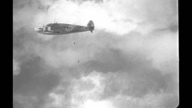 model airplane, bomber attached to wires, flies through clouds dropping miniature bombs. model bomber airplane attached to wires on january 01, 1939 - bomb stock videos & royalty-free footage