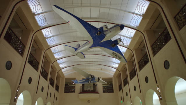 ms pov tu model airplanes hanging from ceiling / sfo museum - museum stock videos & royalty-free footage